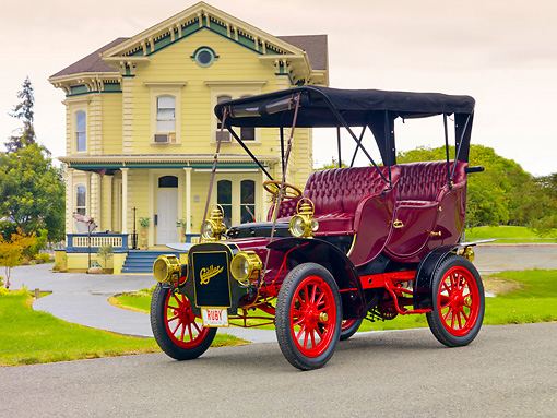 AUT 17 RK0190 01 © Kimball Stock 1907 Cadillac Victoria Touring Model M Burgundy 3/4 Front View On Pavement By House