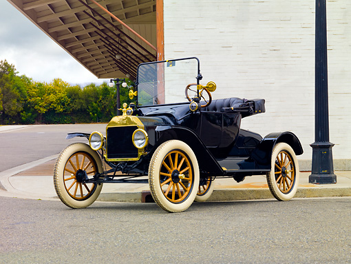AUT 17 RK0191 01 © Kimball Stock 1915 Ford Model T Runabout Black 3/4 Front View On Pavement By Building