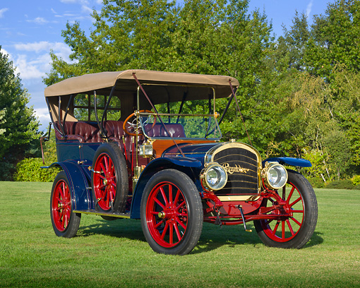 AUT 17 RK0199 01 © Kimball Stock 1910 Rambler Touring Blue 3/4 Front View On Grass By Trees