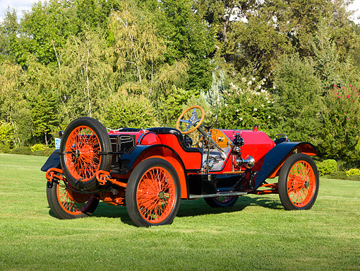 AUT 17 RK0204 01 © Kimball Stock 1913 Stutz Bearcat Red 3/4 Rear View On Grass By Trees