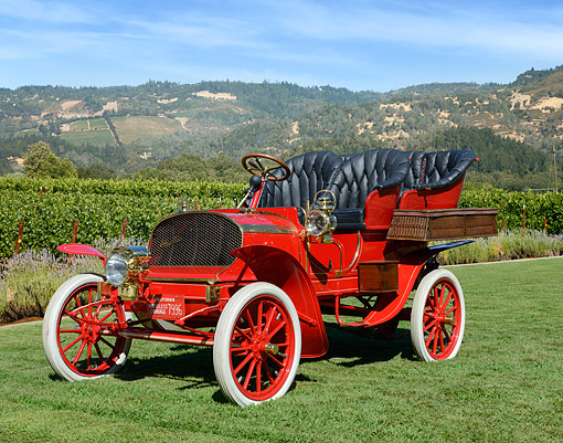 AUT 17 RK0215 01 © Kimball Stock 1905 Franklin Model A Rear Entrance Tonneau Horseless Carraige Red 3/4 Front View On Grass By Hills
