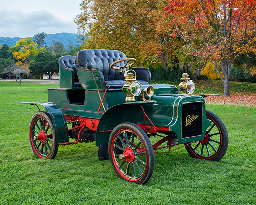 AUT 17 RK0227 01 © Kimball Stock 1903 Cadillac Model B Tonneau Race Car Green 3/4 Front View By Trees