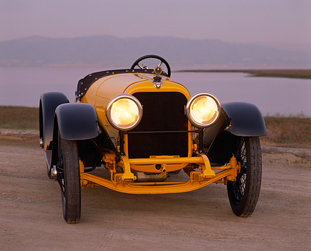 AUT 17 RK0021 03 © Kimball Stock 1918 Mercer Raceabout Yellow 3/4 Front View On Dirt By Water At Dusk