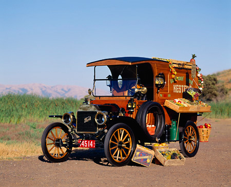 AUT 17 RK0053 17 © Kimball Stock 1914 Ford Model T Delivery Truck 3/4 Front View On Road Green Field Background