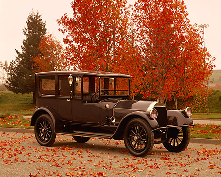 AUT 17 RK0067 06 © Kimball Stock 1917 Pierce Arrow Model 66 Town Car 3/4 Front View On Pavement By Fall Trees