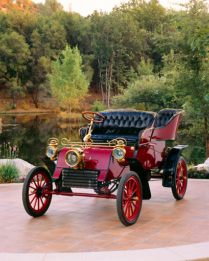 AUT 17 RK0121 03 © Kimball Stock 1903 Ford Model A Runabout Burgundy 3/4 Front View On Tile Floor By Water