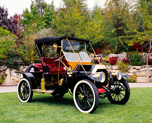 AUT 17 RK0132 03 © Kimball Stock 1911 Overland Model 49 Mother-In-Law Roadster 3/4 Front View On Grass By Trees
