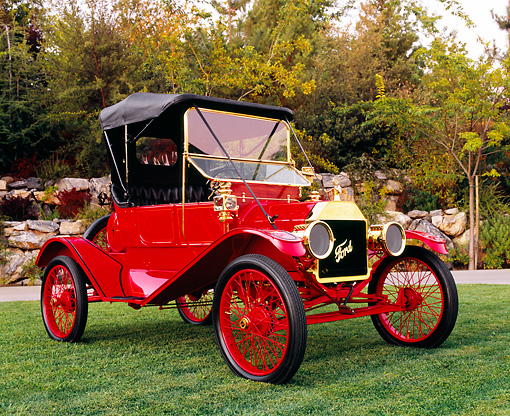 AUT 17 RK0133 02 © Kimball Stock 1911 Ford Model T Torpedo Red And Black 3/4 Front View On Grass By Trees
