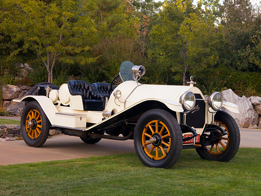 AUT 17 RK0165 01 © Kimball Stock 1914 Mitchell Big Six Speedster White Front 3/4 View On Grass By Trees