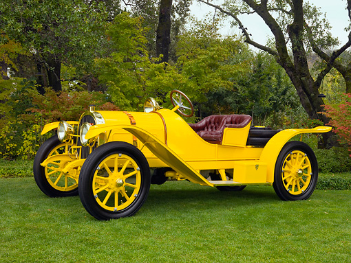 AUT 17 RK0170 01 © Kimball Stock 1913 Pope Hartford Portola Roadster Yellow Front 3/4 View On Grass By Trees