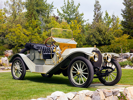 AUT 17 RK0175 01 © Kimball Stock 1912 Mitchell Roadster Green Front 3/4 View On Grass By Trees