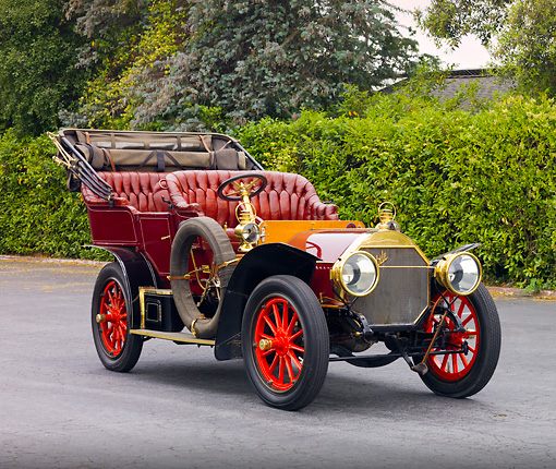 AUT 17 RK0181 01 © Kimball Stock 1906 Locomobile Model H Maroon 3/4 Front View By Shrubs Trees