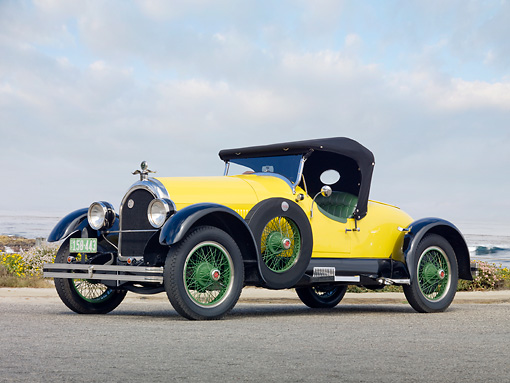 AUT 18 BK0002 01 © Kimball Stock 1924 Kissel 6-55 Speedster Yellow 3/4 Front View On Pavement By Beach