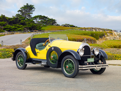 AUT 18 BK0003 01 © Kimball Stock 1924 Kissel 6-55 Speedster Yellow 3/4 Front View On Pavement By Beach