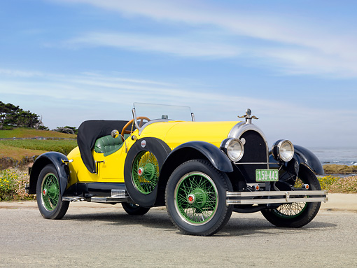 AUT 18 BK0005 01 © Kimball Stock 1924 Kissel 6-55 Speedster Yellow 3/4 Front View On Pavement By Beach
