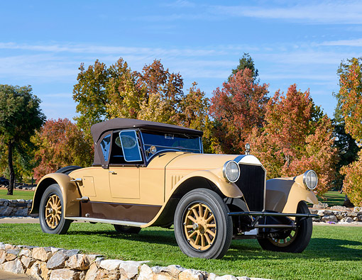 AUT 18 BK0007 01 © Kimball Stock 1924 Pierce-Arrow Series 33 Runabout Beige 3/4 Front View On Grass By Autumn Trees