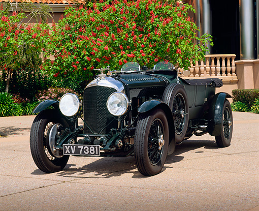 AUT 18 RK0029 04 © Kimball Stock 1928 Bentley Le Mans Racing Car Green 3/4 Front View On Pavement By Tree