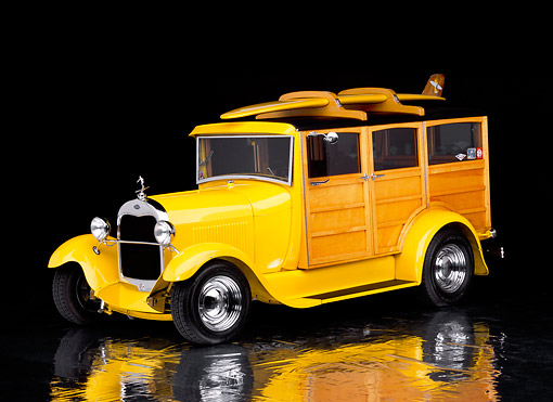 AUT 18 RK0065 20 © Kimball Stock 1929 Ford Woody Street Rod Yellow With Surfboard 3/4 Front View On Mylar Floor Studio