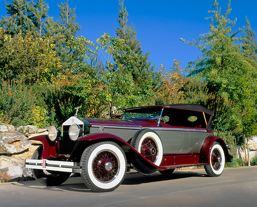 AUT 18 RK0090 02 © Kimball Stock 1929 Rolls Royce P1 Burgundy And Silver Low 3/4 Side View On Pavement By Trees