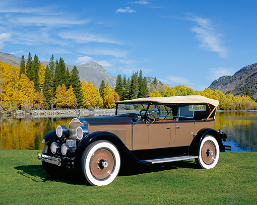 AUT 18 RK0284 04 © Kimball Stock 1926 Packard 326 Phaeton Roadster Brown And Black  Side 3/4 View On Grass By Lake