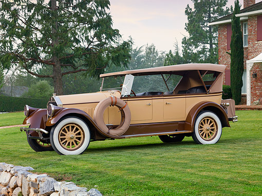 AUT 18 RK0321 01 © Kimball Stock 1928 Pierce-Arrow Model 36 Sedan Tan And Brown 3/4 Front View On Grass By Brick House