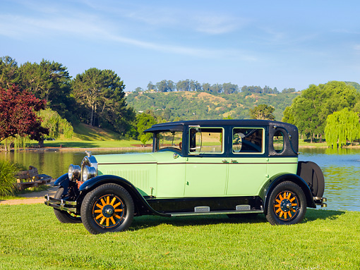 AUT 18 RK0328 01 © Kimball Stock 1927 Buick Master Six Brougham Sedan Green And Black 3/4 Front View On Grass By Lake