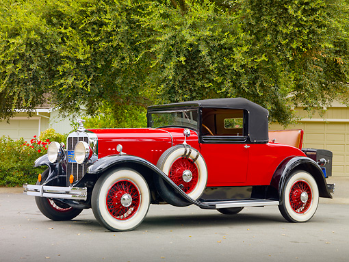 AUT 18 RK0750 01 © Kimball Stock 1929 Franklin Convertible Coupe Red 3/4 Front View On Pavement By Trees