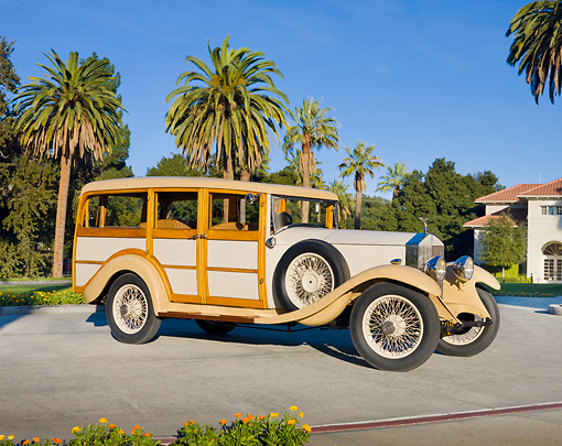 AUT 18 RK0754 01 © Kimball Stock 1929 Rolls-Royce 20 HP Station Wagon Cream 3/4 Front View On Pavement By Trees
