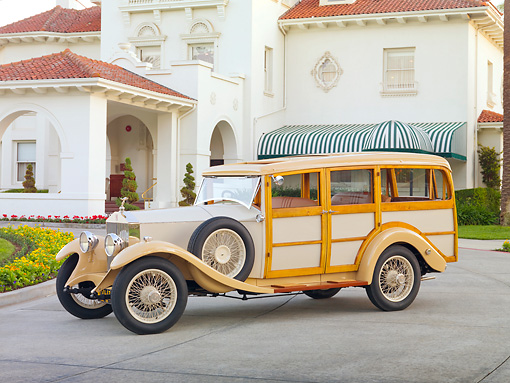 AUT 18 RK0759 01 © Kimball Stock 1929 Rolls-Royce 20 HP Station Wagon Cream 3/4 Front View On Pavement By Building