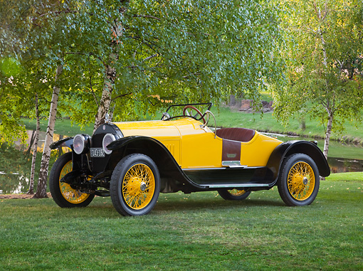 AUT 18 RK0781 01 © Kimball Stock 1920 Stutz Bearcat Yellow 3/4 Side View On Grass By Pond And Trees
