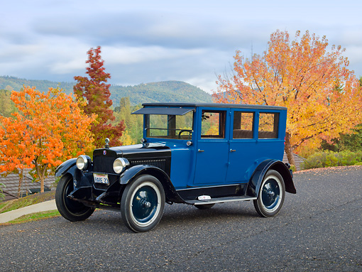 AUT 18 RK0782 01 © Kimball Stock 1923 Columbia 5 Passenger Sedan Blue And Black 3/4 Front View On Pavement By Autumn Trees