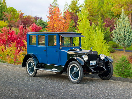 AUT 18 RK0783 01 © Kimball Stock 1923 Columbia 5 Passenger Sedan Blue And Black 3/4 Front View On Pavement By Autumn Trees