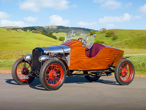 AUT 18 RK0784 01 © Kimball Stock 1926 Ford Model T Speedster Natural Wood 3/4 Side View On Pavement By Grassy Hills