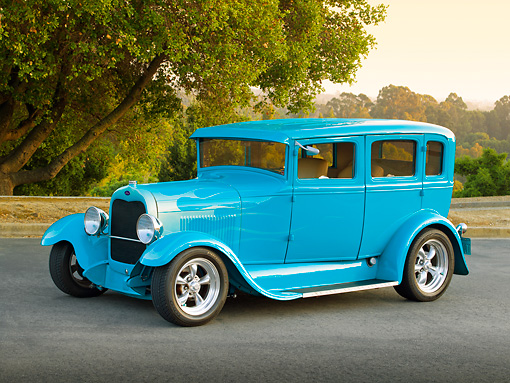 AUT 18 RK0787 01 © Kimball Stock 1929 Ford Tudor Teal 3/4 Side View On Pavement By Trees