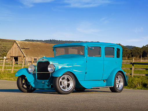 AUT 18 RK0793 01 © Kimball Stock 1929 Ford Tudor Teal 3/4 Front View On Pavement By Old Barn