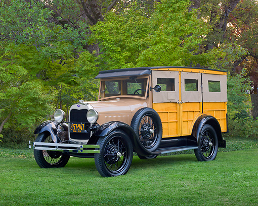 AUT 18 RK0794 01 © Kimball Stock 1929 Ford Station Wagon Manilla Brown 3/4 Front View On Grass By Trees