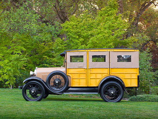 AUT 18 RK0797 01 © Kimball Stock 1929 Ford Station Wagon Manilla Brown Profile View On Grass By Trees