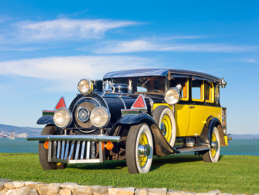 AUT 18 RK0798 01 © Kimball Stock 1929 Graham & Paige Limo Yellow And Black 3/4 Front View On Grass By Water
