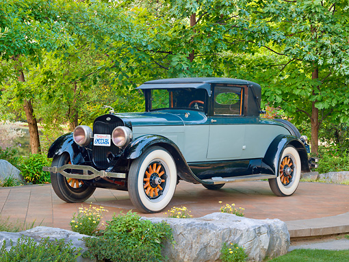 AUT 18 RK0809 01 © Kimball Stock 1925 Lincoln Judkins Coupe Blue 3/4 Front View On Pavement By Trees