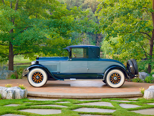 AUT 18 RK0811 01 © Kimball Stock 1925 Lincoln Judkins Coupe Blue Profile View On Pavement By Trees