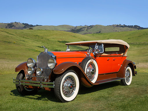 AUT 18 RK0815 01 © Kimball Stock 1929 Packard 645 Dual Cowl Phaeton Orange With Brown Fenders 3/4 Front View On Grass