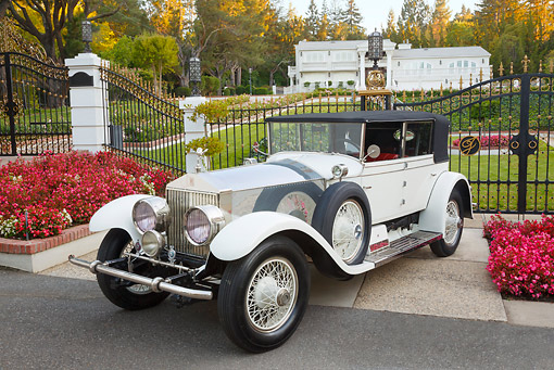 AUT 18 RK0816 01 © Kimball Stock 1927 Rolls-Royce Phantom White 3/4 Front View On Pavement By Gated House