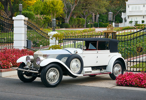 AUT 18 RK0817 01 © Kimball Stock 1927 Rolls-Royce Phantom White 3/4 Side View On Pavement By Gated House