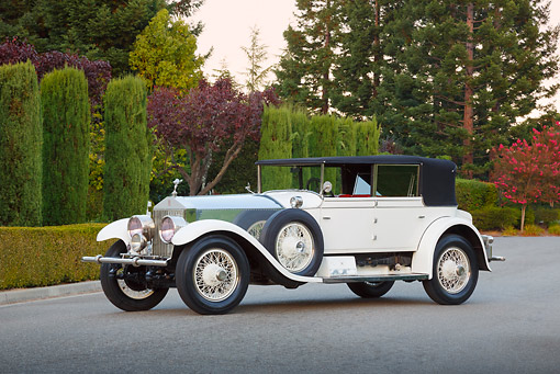 AUT 18 RK0819 01 © Kimball Stock 1927 Rolls-Royce Phantom White 3/4 Side View On Pavement By Shrubs And Trees