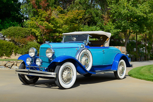 AUT 18 RK0829 01 © Kimball Stock 1929 Chrysler 75 Roadster Blue 3/4 Front View On Pavement By Trees