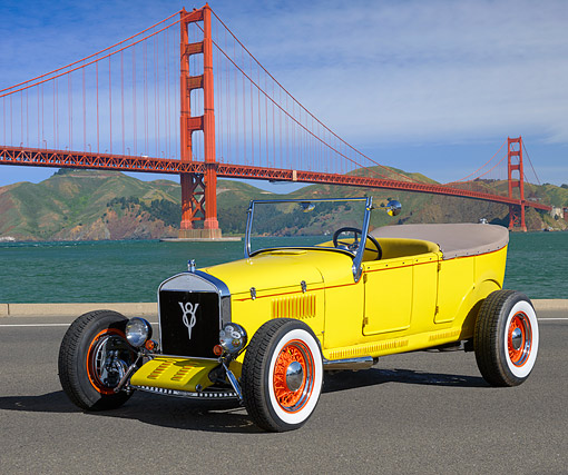 AUT 18 RK0834 01 © Kimball Stock 1926 Ford Model T Yellow 3/4 Front View On Pavement By Golden Gate Bridge