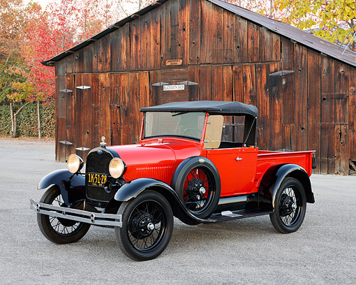 AUT 18 RK0848 01 © Kimball Stock 1929 Ford A Truck Red And Black 3/4 Front View On Gravel By Barn