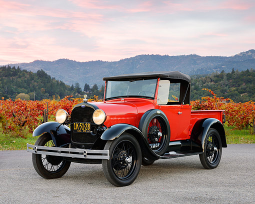 AUT 18 RK0849 01 © Kimball Stock 1929 Ford A Truck Red And Black 3/4 Front View On Gravel By Autumn Vineyard