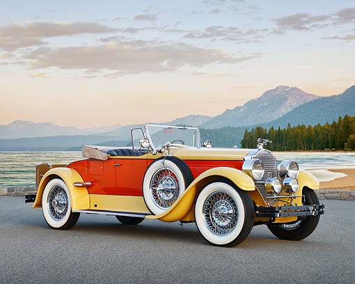 AUT 18 RK0850 01 © Kimball Stock 1927 Packard Series 6 Roadster Yellow And Orange 3/4 Side View On Pavement By Beach
