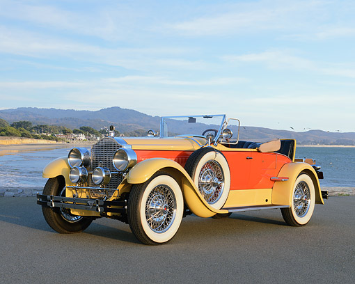 AUT 18 RK0851 01 © Kimball Stock 1927 Packard Series 6 Roadster Yellow And Orange 3/4 Front View On Pavement By Beach